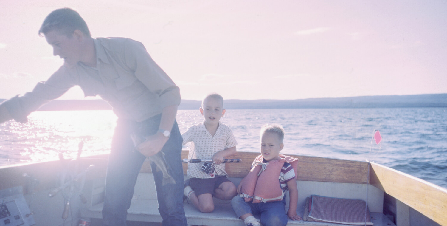 A defendant who is also a good father spends time with his young children on a boat in the ocean